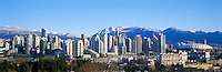"City of Vancouver Skyline and Downtown at Yaletown and ""False Creek"", BC, British Columbia, Canada, in Spring.  The North Shore Mountains (Coast Mountains) rise above the City. - Panoramic View (Historical Roof on BC Place)"