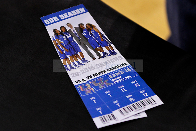 A pair of UK hoops tickets to senior day sit on a chair after the second half of the UK vs. South Carolina at Memorial Coliseum in Lexington , Ky., on Sunday, March 1, 2015. Photo by Jonathan Krueger | Staff