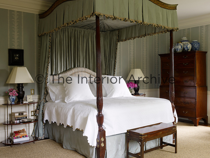 The master bedroom is dominated by a fabulous four-poster bed with drapes of eau de nil silk
