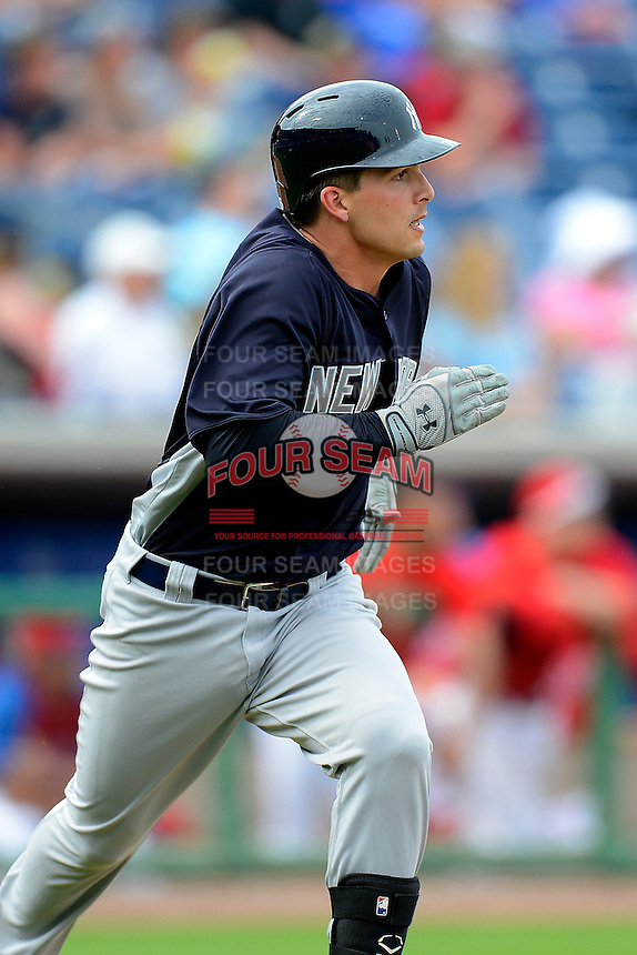 New York Yankees catcher J.R. Murphy #76 runs to first after hitting a home run to center during a Spring Training game against the Philadelphia Phillies at Bright House Field on February 26, 2013 in Clearwater, Florida.  Philadelphia defeated New York 4-3.  (Mike Janes/Four Seam Images)