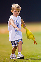 A young fan tosses a rubber chicken during a between innings contest at Boyce Cox Field August 27, 2010, in Bristol, Tennessee.  Photo by Brian Westerholt / Four Seam Images