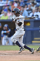 Charleston RiverDogs shortstop Jorge Mateo (2) swings at a pitch during a game against the Asheville Tourists on June 13, 2015 in Asheville, North Carolina. The Tourists defeated the RiverDogs 10-6. (Tony Farlow/Four Seam Images)