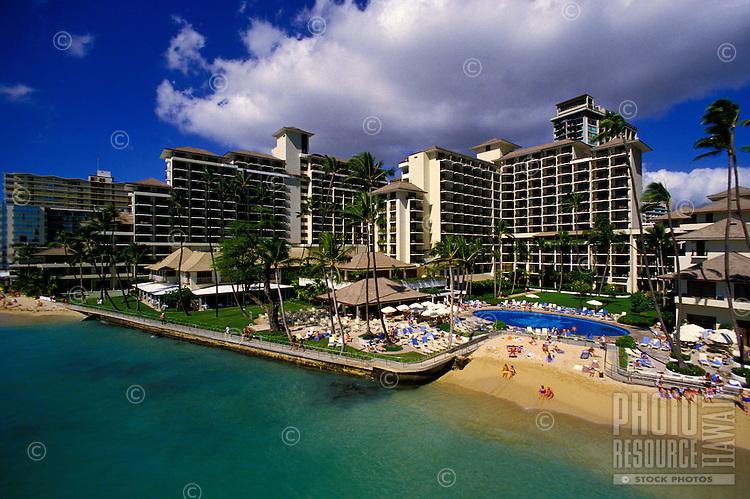 Aerial view of Halekulani Hotel, surrounding establishments, and the beachfront in Waikiki