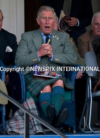"PRINCE CHARLES - THE JOKER.The Prince kept family members who included The Queen, Prince Philip and Princess Anne entertained compensating for the rainy Braemar Gathering, Braemar, Scotland_05/09/09.Mandatory Credit Photo: ©DIAS-NEWSPIX INTERNATIONAL..Please telephone : +441279324672 for usage fees..**ALL FEES PAYABLE TO: ""NEWSPIX INTERNATIONAL""**..IMMEDIATE CONFIRMATION OF USAGE REQUIRED:.Newspix International, 31 Chinnery Hill, Bishop's Stortford, ENGLAND CM23 3PS.Tel:+441279 324672  ; Fax: +441279656877.Mobile:  07775681153.e-mail: info@newspixinternational.co.uk"