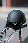 Matte black half shell motorcycle helmet on handle bar