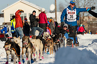 Brett Bruggeman gives high-fives on Cordova Street with his Iditarider during the ceremonial start of the 2019 Iditarod in downtown Anchorage, Alaska on Saturday March 2.<br /> <br /> Photo by Jeff Schultz/  (C) 2019  ALL RIGHTS RESERVED