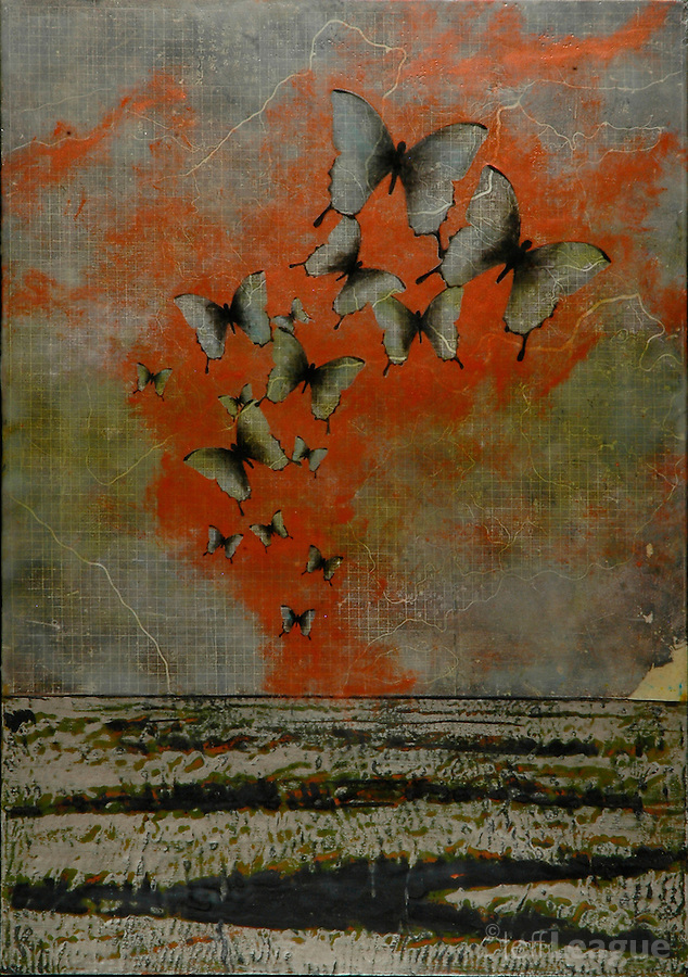 Metallic encaustic painting of butterflies over antique map.