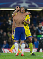 Cesc Fabregas of Chelsea hugs Tal Ben Haim I(former Chelsea player) of Maccabi Tel Aviv after the final whistle during the UEFA Champions League match between Chelsea and Maccabi Tel Aviv at Stamford Bridge, London, England on 16 September 2015. Photo by Andy Rowland.