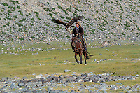 Mongolia, Bayan-Ulgii, Ulgii, Altai Mountains near Tsambagarav Mountain. Shaimurat, famous award winning eagle hunter.