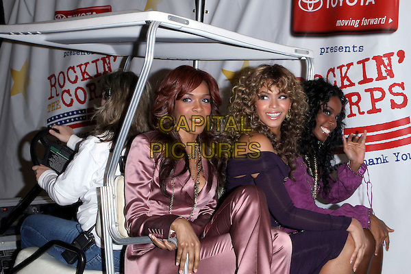"DESTINY'S CHILD - KELLY ROWLAND, BEYONCE KNOWLES & MICHELLE WILLIAMS.""Rockin The Corps"" - Concert Celebration for U.S. Marines held at Camp Pendleton Marine Corp Base..April 1st, 2005.Photo credit: Jacqui Wong/AdMedia.half length looking over shoulder off the shoulder golf cart.www.capitalpictures.com.sales@capitalpictures.com.© Capital Pictures."