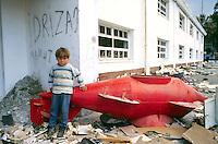 - Albania, child between the ruins of the Naval Academy in the city of Valona after the civil war of spring 1997....- Albania, bambino fra le macerie dell'Accademia Navale nella città di Valona dopo la guerra civile della primavera 1997