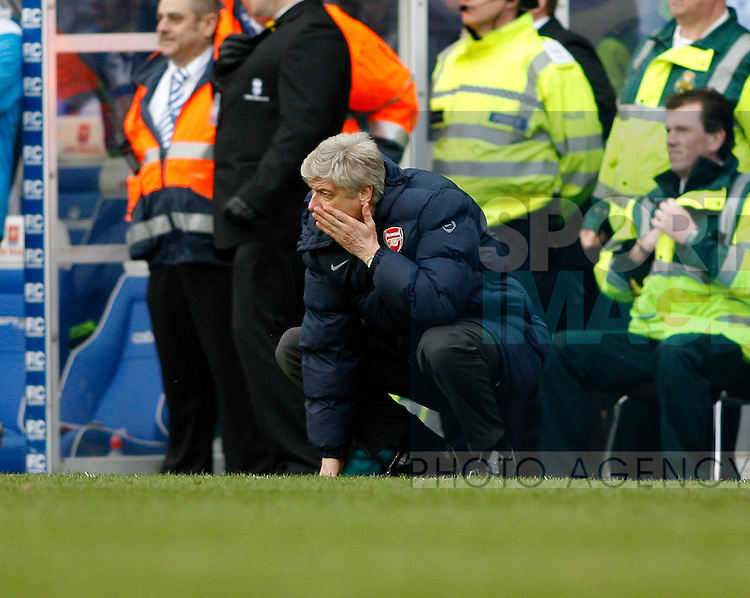 Arsenal's Arsene Wenger reacts after his side concede a late goal