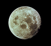In Space - (FILE) -- This photograph of the full Moon was taken from Apollo 11 during its trip back to Earth from a distance of roughly 18,000 km. The picture is centered at approximately 5 N, 55 E, the round smooth area just above the center of the disk is Mare Crisium, left of that is Mare Tranquilitatis. The Apollo 11 landing site is along the left side of Tranquilitatis. The Moon is about 3480 km in diameter and north is at roughly 11:30..Credit: NASA via CNP