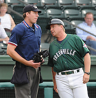 July 5, 2009: Manager Kevin Boles (19) of the Greenville Drive gets in the face of home plate umpire Joel Myers after he got ejected from a game against the Savannah Sand Gnats at Fluor Field at the West End in Greenville, S.C.  Photo by: Tom Priddy/Four Seam Images