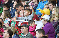 Wales fans in the stadium<br /> <br /> Wales Vs England - men's classification 5th - 6th place match<br /> <br /> Photographer Chris Vaughan/CameraSport<br /> <br /> 20th Commonwealth Games - Day 4 - Sunday 27th July 2014 - Rugby Sevens - Ibrox Stadium - Glasgow - UK<br /> <br /> © CameraSport - 43 Linden Ave. Countesthorpe. Leicester. England. LE8 5PG - Tel: +44 (0) 116 277 4147 - admin@camerasport.com - www.camerasport.com