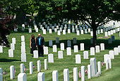 "United States President Donald J. Trump and First Lady Melania Trump visit Arlington National Cemetery ahead of Memorial Day during the ""Flags-In"" ceremony, in Arlington, Virginia on May 23, 2019. ""Flags-In"" is an annual event where the 3rd U.S. Infantry Regiment, ""The Old Guard,"" places American flags at every gravesite at Arlington National Cemetery. <br /> Credit: Kevin Dietsch / Pool via CNP"