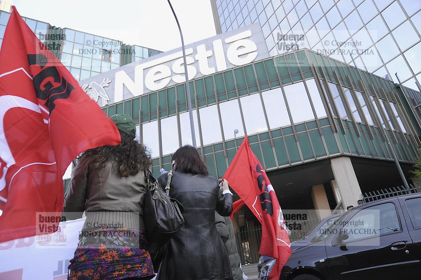 - demonstration of Nestle multinational employees in front of Milan headquarters against 282 dismissals in various companies of group<br /> <br /> - manifestazione di dipendenti della multinazionale Nestl&egrave; davanti alla sede centrale di Milano contro 282 licenziamenti in varie societ&agrave; del gruppo