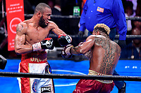 """Fairfax, VA - May 11, 2019: Julian J-Rock"""" Williams throws a left hook against Jarrett """"Swift"""" Hurd during Jr. Middleweight title fight at Eagle Bank Arena in Fairfax, VA. Julian Williams defeated Hurd to take home the IBF, WBA and IBO Championship belts by unanimous decision. (Photo by Phil Peters/Media Images International)"""