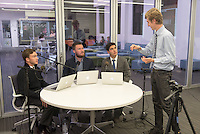 From left, Donovan Dennis '16, Mason Atkins '15 and Ricardo Parada '18 get some last minute advice from Allan Van Vliet '15. Occidental College students host Electapalooza in the Varelas Innovation Lab for the 2014 midterm elections on election night, Tuesday, Nov. 4, 2014. Sponsored by KOXY, the Occidental Weekly, and CatAlist TV, in partnership with the CDLR, the Critical Making Studio, and the Occidental Politics Department. (Photo by Marc Campos, Occidental College Photographer)