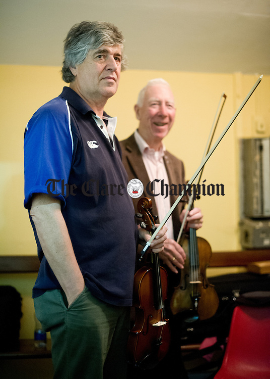 Paddy Glacken and Charlie Lennon waiting in the green room before performing in a concert as part of the Willie Clancy Summer school in Miltown Malbay. Photograph by John Kelly.