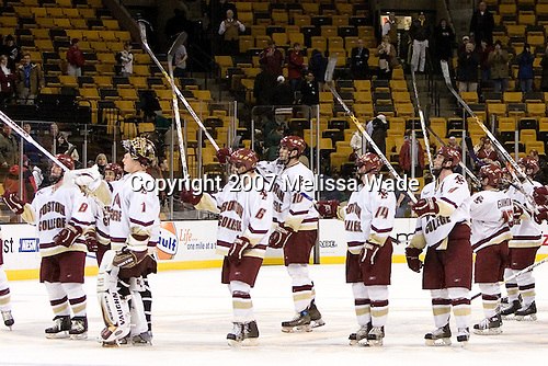 Boston College salutes their fans. The Boston College Eagles defeated the Harvard University Crimson 3-1 in the first round of the 2007 Beanpot Tournament on Monday, February 5, 2007, at the TD Banknorth Garden in Boston, Massachusetts.  The first Beanpot Tournament was played in December 1952 with the scheduling moved to the first two Mondays of February in its sixth year.  The tournament is played between Boston College, Boston University, Harvard University and Northeastern University with the first round matchups alternating each year.
