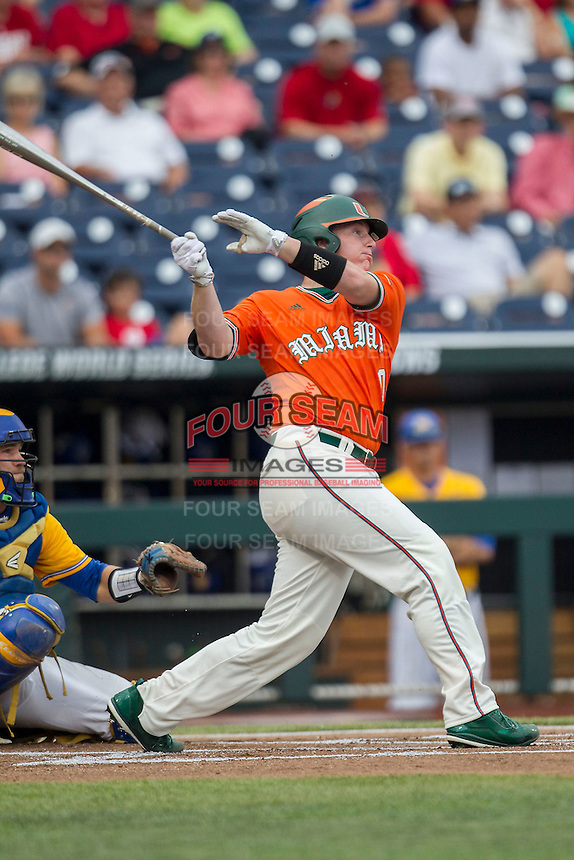 Miami Hurricanes catcher Zack Collins (0) smashes a first inning home run against the UC Santa Barbara Gauchos in Game 5 of the NCAA College World Series on June 20, 2016 at TD Ameritrade Park in Omaha, Nebraska. UC Santa Barbara defeated Miami  5-3. (Andrew Woolley/Four Seam Images)