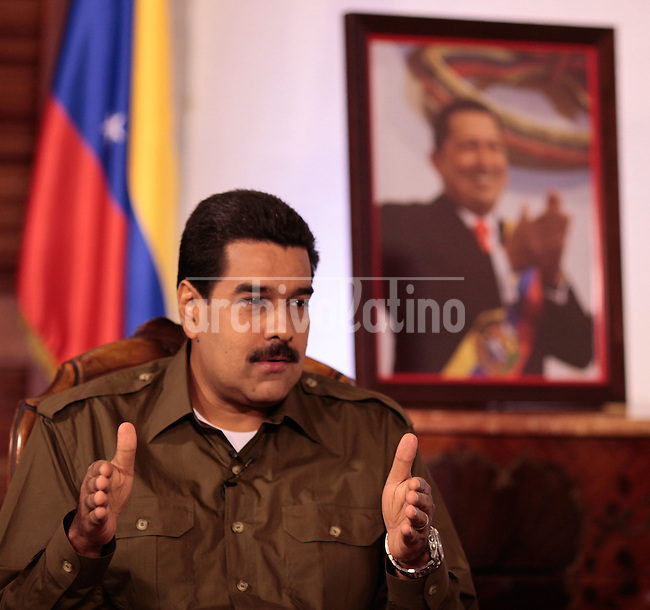 Venezuelan President and presidential candidate Nicolas Maduro during an interview with Venevision TV station in Caracas.Maduro will face opposition leader Henrique Capriles in a national election to choose the successor of Hugo Chavez