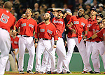 Boston, MA, June 18, 2013: Members of the Red Sox, including Jacoby Ellsbury, Dustin Pedroia, Will Middlebrooks, David Ortiz and Daniel Nava, watch in awe as outfielder Jonny Gomes kicks his helmet into the air as he rounds third base following his game winning walk off two run homerun. (Photo by Michael Cummo/Boston Red Sox)