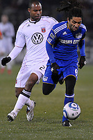 Stephane Auvray 8) gets ahead of Julius James...Kansas City Wizards defeated D.C Utd 4-0 in their home opener at Community America Ballpark, Kansas City, Kansas.