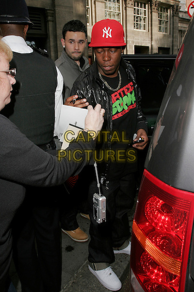 DIZZEE RASCAL (Dylan Mills).Leaving the 54th Ivor Novello awards at the Grosvenor House Hotel, London, England. .May 21st, 2009 .full white trainers sneakers signing autographs length black leather jacket jeans denim top red baseball cap hat .CAP/AH.©Adam Houghton/Capital Pictures.