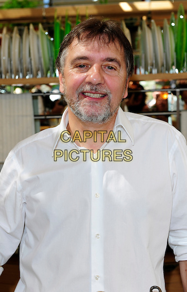RAYMOND BLANC .The Chelsea Flower Show - Press & VIP Day at Royal Hospital Chelsea. .London, England, UK, 24th May 2010..half length white shirt beard facial hair smiling .CAP/CJ.©Chris Joseph/Capital Pictures.