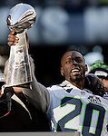 Seahawks cornerback Jeremy Lane (20) holds up the Vince Lombardi Trophy during the Super Bowl XLVIII celebration at  CenturyLink Field on February 5, 2014 in Seattle. ©2014. Jim Bryant Photo. ALL RIGHTS RESERVED.