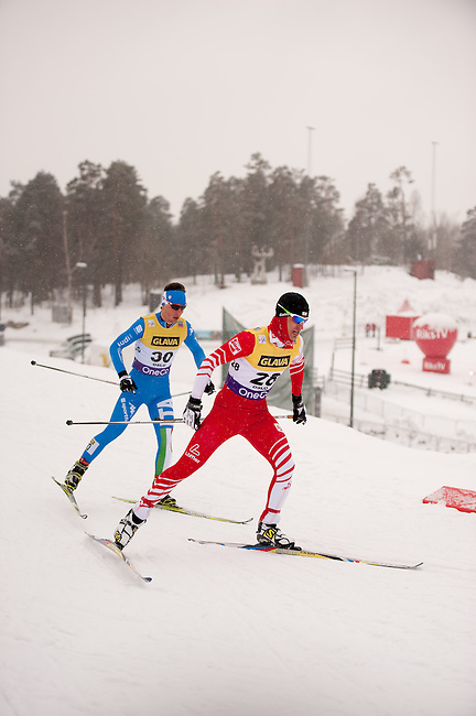 HOLMENKOLLEN, OSLO, NORWAY - March 15: (R-L) Lukas Klapfer of Austria (AUT) and Armin Bauer of Italy (ITA) during the cross country 10 km (4 x 2.5 km) competition at the FIS Nordic Combined World Cup on March 15, 2013 in Oslo, Norway. (Photo by Dirk Markgraf)