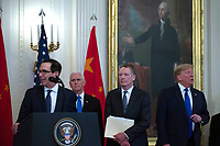 United States Vice President Mike Pence, United States Trade Representative Robert Lighthizer, and United States President Donald J. Trump listen as United States Secretary of the Treasury Steven T. Mnuchin delivers remarks before the signing of a trade agreement between the United States and China in the East Room of the White House in Washington D.C., U.S., on Wednesday, January 15, 2020.  <br /> <br /> Credit: Stefani Reynolds / CNP/AdMedia