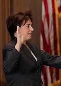 Elena Kagan takes the oath of office as the Supreme Court's newest member, administered by Chief Justice John Roberts, not shown, at the Supreme Court Building in Washington, Saturday, August 7, 2010. Kagan, 50, replaces retired Justice John Paul Stevens, and is the fourth woman to sit on the high court. She is the first Supreme Court justice in nearly four decades with no previous experience as a judge. .Mandatory Credit: J. Scott Applewhite - Pool via CNP