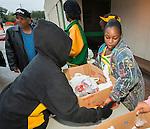 Student volunteers distribute food to Sunnyside residents at Worthing High School, November 22, 2013.