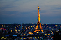 Evening view of the Eiffel Tower from Sacre-Coeur, a popular landmark on top of Montmartre, the highest point in Paris, France.