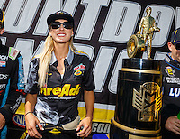 Sep 18, 2016; Concord, NC, USA; NHRA top fuel driver Leah Pritchett alongside the championship trophy during the Carolina Nationals at zMax Dragway. Mandatory Credit: Mark J. Rebilas-USA TODAY Sports