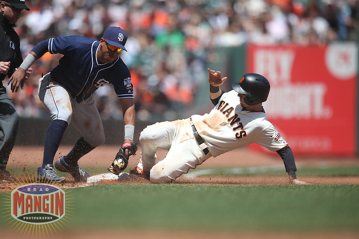 SAN FRANCISCO, CA - MAY 25:  Matt Duffy #5 of the San Francisco Giants steals third base as San Diego Padres third baseman Yangervis Solarte #26 applies the late tag during the game at AT&T Park on Wednesday, May 25, 2016 in San Francisco, California. Photo by Brad Mangin