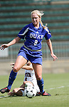 Carolyn Riggs (8), of Duke, evades a tackle by NC State's Jessica O'Rourke (6) on Sunday October 2nd, 2005 at SAS Stadium in Cary, North Carolina. The Duke University Blue Devils defeated the North Carolina State University Wolfpack 1-0 during an Atlantic Coast Conference women's soccer game.