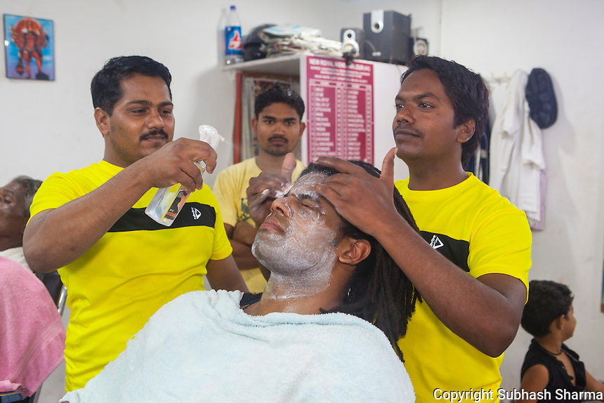 14 July 2016 - Pune - INDIA.<br /> Jamal Idris at a local Barber's Saloon at Balewadi village at Pune.<br /> <br /> (Subhash Sharma for the Sunday Telegraph)