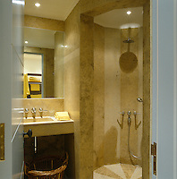 A small shower room accessorised with yellow towels