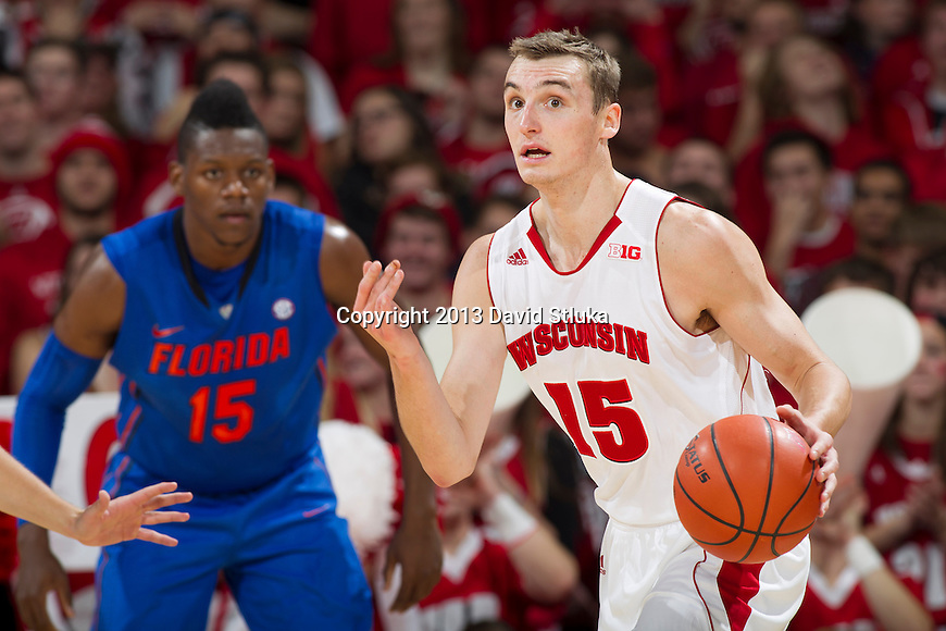 Wisconsin Badgers forward Sam Dekker (15) handles the ball during an NCAA college basketball game against the Florida Gators Tuesday, November 12, 2013, in Madison, Wis. The Badgers won 59-53. (Photo by David Stluka)