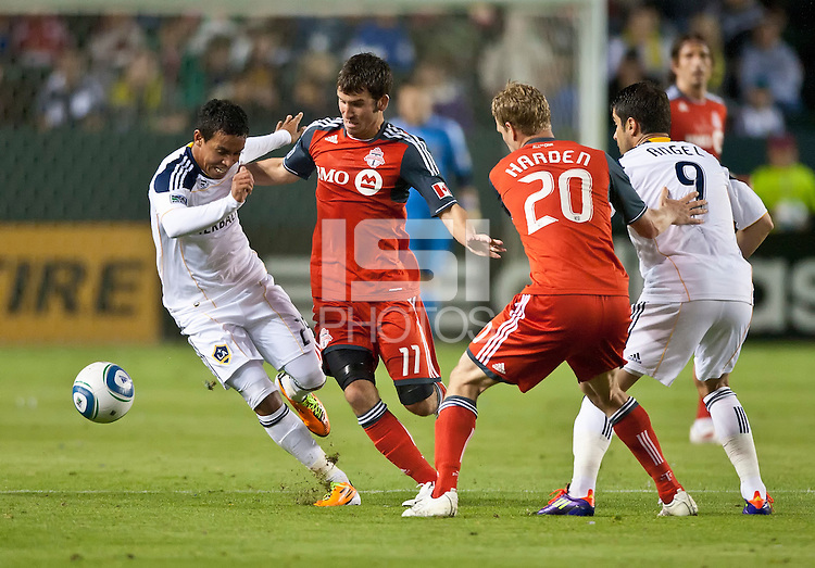 CARSON, CA – June 11, 2011: LA Galaxy midfielder Miguel Lopez (25) and Toronto FC midfielder Nathan Sturgis (11) during the match between LA Galaxy and Toronto FC at the Home Depot Center in Carson, California. Final score LA Galaxy 2, Toronto FC 2.