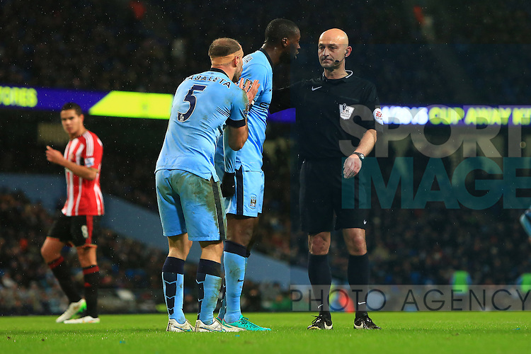 Yay Toure and Pablo Zabaleta of Manchester City confront the referee - Manchester City vs. Sunderland - Barclay's Premier League - Etihad Stadium - Manchester - 28/12/2014 Pic Philip Oldham/Sportimage