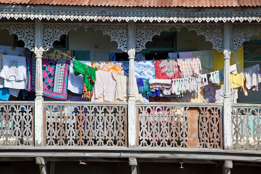Stone Town, Zanzibar, Tanzania.  Indian-Style Balcony Railing, Laundry Drying.