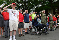 Photo by Randy Litzinger<br /> <br /> Veterans Rick Brooke, Bryan Park, J.D. Davenport, Mike Freeman, triple amputee Larry Bailey, Russ Claar, Rex Wagaman, and Tim Nosal salute during the national anthem during the Star Spangled First Friday Warrenton 7-6-18.