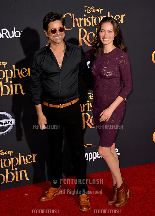 John Stamos &amp; Caitlin McHugh at the world premiere of Disney's &quot;Christopher Robin&quot; at Walt Disney Studios, Burbank, USA 30 July 2018<br /> Picture: Paul Smith/Featureflash/SilverHub 0208 004 5359 sales@silverhubmedia.com