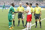 19 August 2008: Captains Victor Obinna (NGA) (9) and Maarten Martens (BEL) (11) shake hands before the game.  The men's Olympic soccer team of Nigeria defeated the men's Olympic soccer team of Belgium 4-1 at Shanghai Stadium in Shanghai, China in a Semifinal match in the Men's Olympic Football competition.
