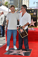 LOS ANGELES, CA. August 22, 2018: Louis Tomlinson & Simon Cowell at the Hollywood Walk of Fame Star Ceremony honoring Simon Cowell.